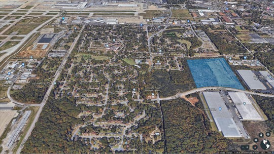 The blue shaded area shows where the trucking terminal would be located. Memphis International Airport is at the left side of the image. A neighborhood is located just to the west of the proposed development. According to construction permits, the site address is 3430 - 3464 Raines Road.