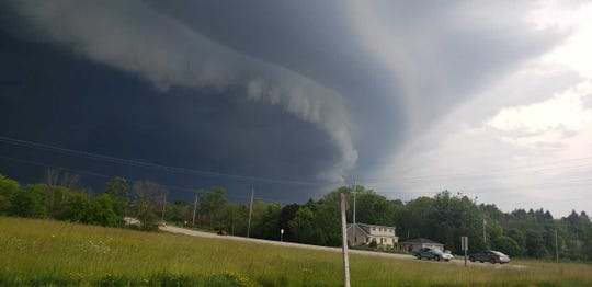 Ominous-looking storm clouds moved through much of Wisconsin on Thursday. This photo was taken at 5:18 p.m. at state Highway 33 and Ozaukee County Highway I near Saukville.