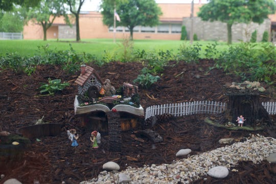 Two fairy houses can be seen in the fairy garden outside the Wauwatosa Public Library. The garden faces a large window in the children's section.