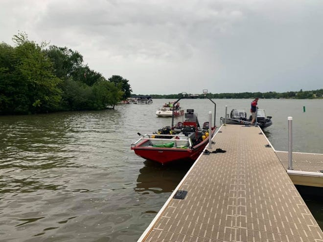 Fire and police departments responded to a report that multiple kayaks capsized on Lake Lac La Belle on June 27. The people were later found safe on land.