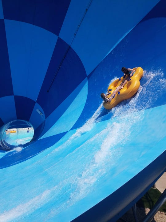 The Boomerang waterslide sends riders up and down the sides of the funnel on their way down.