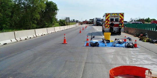 Concrete sealant and bonding and stripping agents coat I-94 northbound lanes on a bridge over the Root River after a semitruck spilled the chemicals. The crash and ensuing cleanup and road repair closed the interstate for nearly 13 hours Friday.