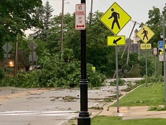 Even from a distance, the downed power lines on East Avenue are evident after straight line winds burst through Carroll University on Thursday, June 27. The Waukesha campus was particularly hard hit by the winds, and school officials were still trying to assess the damage and clean up the following day.