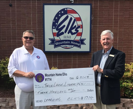 The Mountain Home Elks Lodge recently donated $300 to the Twin Lakes Literacy Council. The Twin Lakes Literacy Council is a non-profit organization that provides free tutoring to children and adults in the Twin Lakes area. Pictured are: (from left) Chris Robinson, Elks Benevolence chairman, and Phil Garner, TLLC Board chairman.