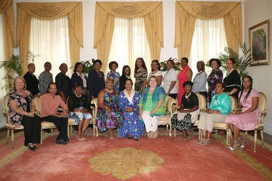 Pilot International President Karen Cupit (front row, fourth from right) met Governor General of the Bahamas Marguerite Pindling (front row, center) in 2018 as part of her travels for the club.