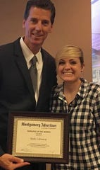 Montgomery Advertiser president Michael Galvin with Holly Calloway in 2017, when Calloway received an employee of the month award.
