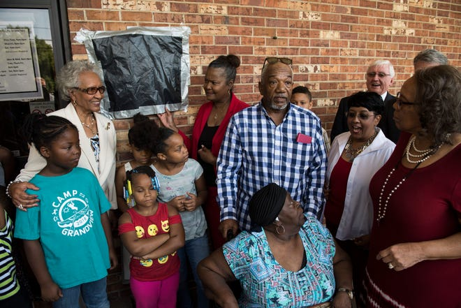 Guest prepare for the unveiling during a historical marker commemoration for Bertha Pleasant Williams Library in Montgomery, Ala., on Friday, June 28, 2019. The commemoration was held the day before what would have been Williams' 96th birthday.