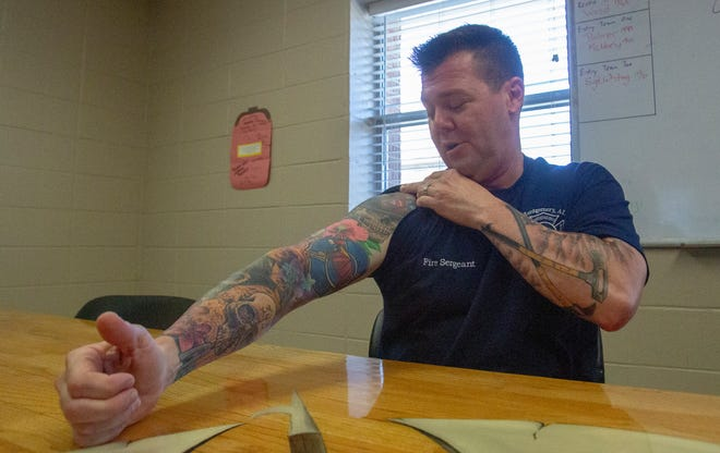 Sgt. Alex Cecil wears his career on his arms with tattoos representing various Montgomery Fire/Rescue units he's worked on throughout his 20-year career.