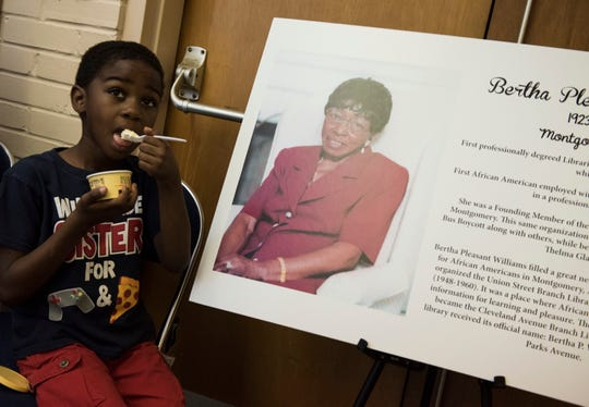 Kids enjoy ice cream and cake during a historical marker commemoration for Bertha Pleasant Williams Library in Montgomery, Ala., on Friday, June 28, 2019. The commemoration was held the day before what would have been Williams' 96th birthday.