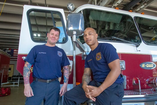 Sgt. Alex Cecil and Lt. Eric Seals show off their tattoos after a new policy at the Montgomery Fire Department allowed them to leave their ink uncovered.
