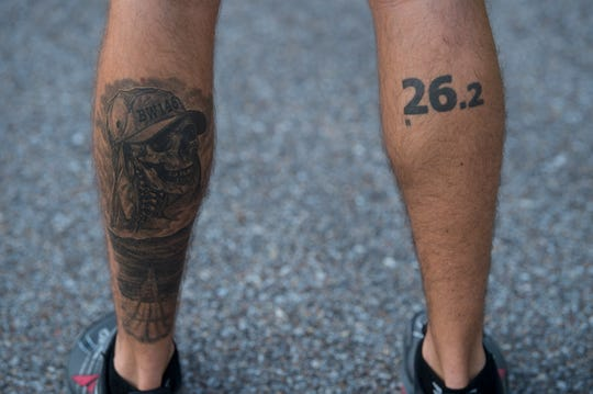 Jared Struck shows his tattoos for a previous Badwater race and marathons in Wetumpka, Ala., on Friday, June 28, 2019. Struck is training for the Badwater 135 race, a 135-mile race that could last two days.