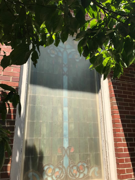 Stained glass windows at the former First United Methodist Church on College Street in downtown Murfreesboro, built in 1888, are shown.  The city has sold the property, which will be redeveloped to include a hotel, along with residential and commercial uses.