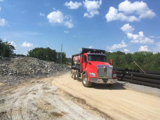 A truck passes through where crews are building a three-lane Enon Springs Road West that's expected to be done by the end of 2019. The project will extend Enon Springs from Old Nashville Highway to Rocky Fork Road near the new Rocky Fork Elementary and neighboring Rocky Fork Middle. The extension also will be a short drive from a Rocky Fork Road overpass of Interstate 24 where town officials hope an interchange will be built.