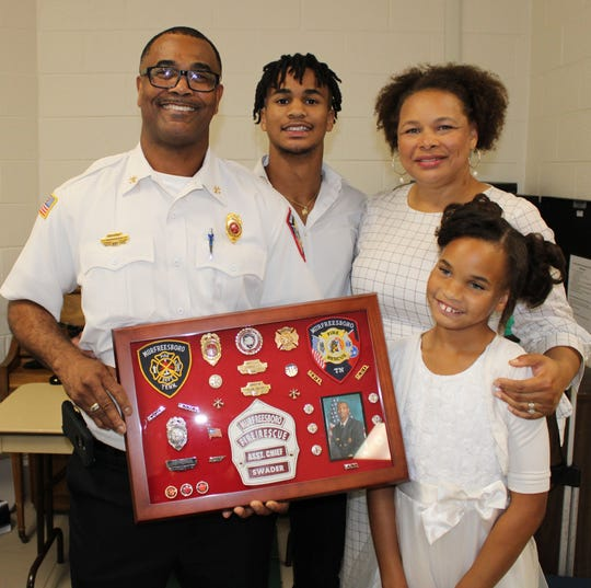 Murfreesboro Fire Rescue Department Assistant Chief Allen Swader will retire July 1. He is pictured at a recent retirement celebration with wife Lisa, son Zion and daughter Amari.