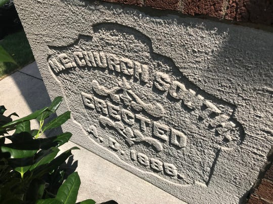 A marker indicates the construction date of the former First United Methodist Church on College Street in downtown Murfreesboro. Built in 1888, the site has been sold and will be redeveloped to include a hotel, along with residential and commercial uses.
