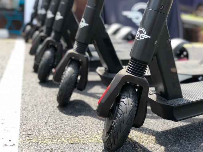 Bird Scooters lined up waiting for riders in East Nashville