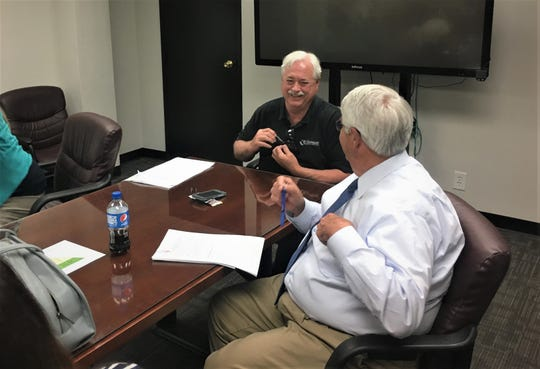 Steve Smith, Williamson County Budget Committee chairman, and County Mayor Rogers Anderson talk during a recent budget committee meeting at the county administrative building.
