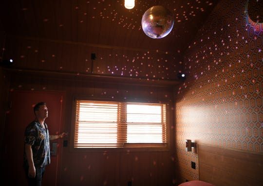 Hotelier Lyon Porter gives a tour of the hotel rooms at The Dive Motel & Swim Club, which all include a disco ball.