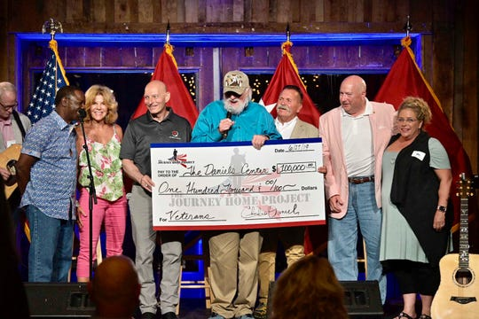 Charlie Daniels presents MTSU's Daniels Center with a $100,000 donation on behalf of the Journey Home Project. From left: MTSU president Sidney McPhee, Carolyn Corlew, Lt. Gen. Keith M. Huber, Charlie Daniels, David Corlew, General Max Haston, Angela Wheeler