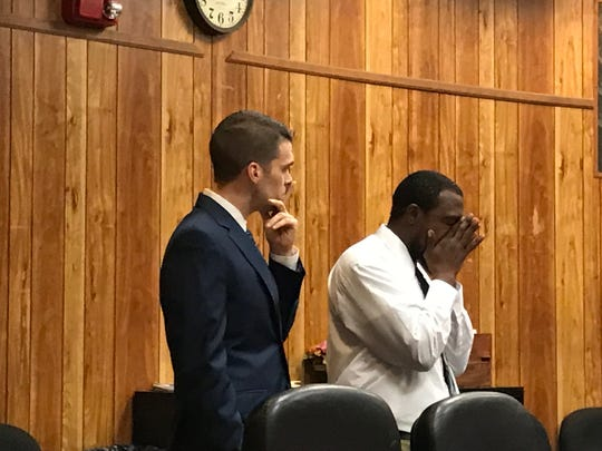 Kevuahgn Wright, (R), with his attorney, Nicholas Patullo while the verdict is read.