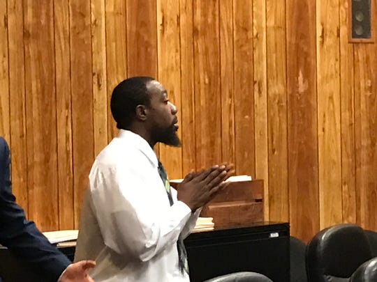 Kevaugh Wright listens to the verdict