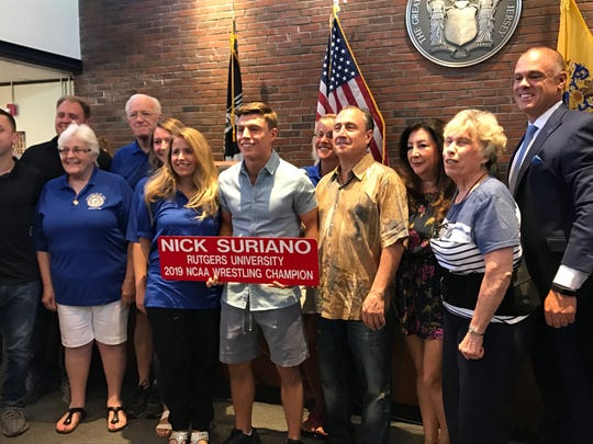 Nick Suriano, a Rutgers student who won the NCAA national wrestling championship in March, was honored by the mayor and council on June 27 with a street sign. The sign will eventually be hung on Paramus Road.