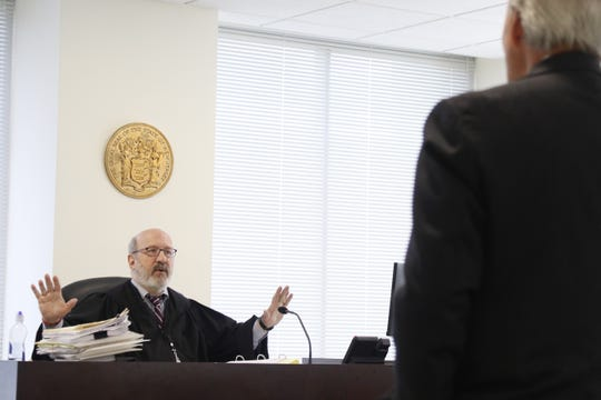 Judge Andrew Baron has a procedural argument with the attorney representing the City of Hackensack, Raymond Wiss on day two of hearings for the Hackensack cops at the New Jersey Office for Administrative Law in Newark on June 28, 2019. The cops are litigating their termination.