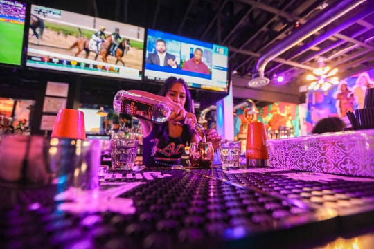 Bartenders serve drinks at Rad Retrocade on Main Street in Downtown Las Cruces on Friday, June 28, 2019.