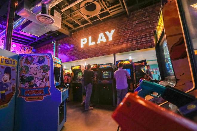 Customers play retro video games at Rad Retrocade on Main Street in Downtown Las Cruces on Friday, June 28, 2019.