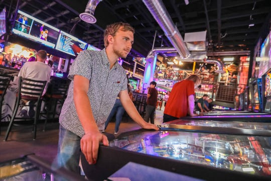 Patrick Downey plays pinball at Rad Retrocade on Main Street in Downtown Las Cruces on Friday, June 28, 2019.