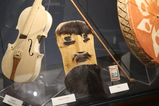 Artifacts are on display at an photo exhibit, June 28, 2019 at the Carlsbad Museum and Art Center.