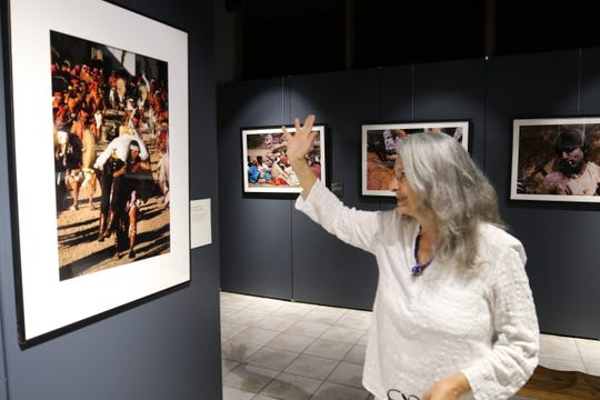 Diana Molina gives a tour of her art photo exhibit, June 28, 2019 at the Carlsbad Museum and Art Center.