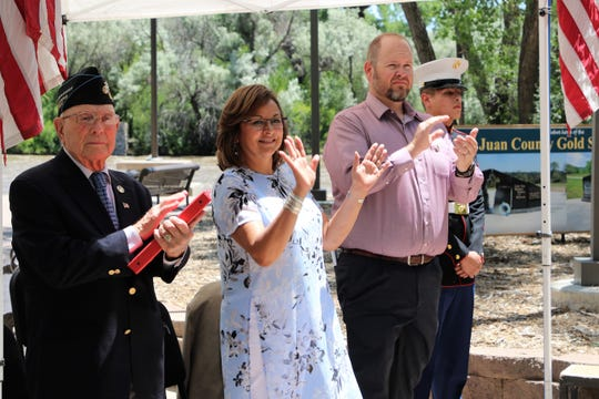 "Hershel ""Woody"" Williams, left, former Governor Susana Martinez, center and Farmington Mayor Nate Duckett, right, applaud during the ground-breaking ceremony on June 27 for the SJC Gold Star Families Memorial Monument at All Veterans Memorial Plaza in Animas Park."