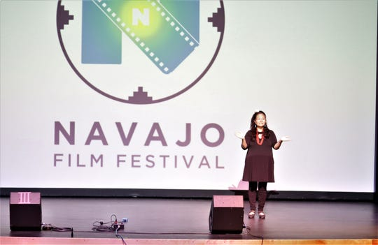 Emcee Chizz Bah addresses the crowd at the second annual Navajo Film Festival June 22 in Shiprock.