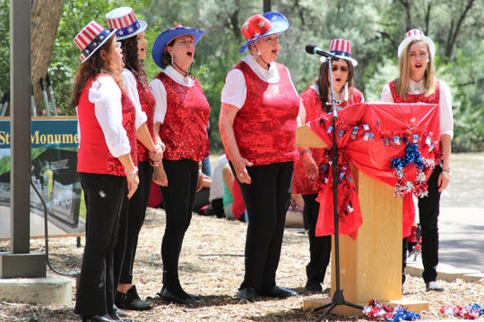 Members of the Glitter Bugs perform a song during the ground-breaking ceremony on June 27 for the SJC Gold Star Families Memorial Monument at All Veterans Memorial Plaza in Animas Park.