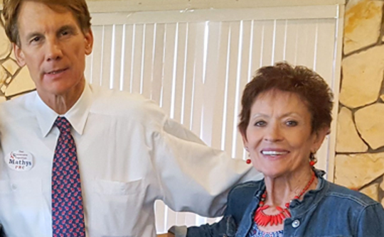 Republican congressional candidate Chris Mathys vsitied with Ev Burton during a recent meeting of the Federated Repujblican Women of Lincoln County.