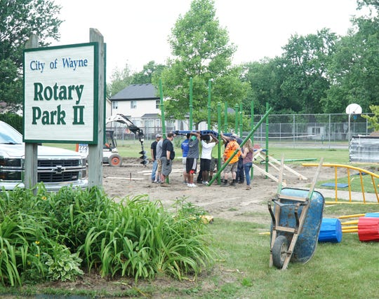 Rotarians and Wayne officials and residents work on constructing a playground space on Chamberlain Street on June 28, 2019.