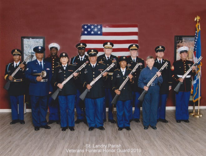Members of the St. Landry Parish Veterans Funeral Honor Guard. First row, left to right:  Sgt. Craig Shilow, USAF; Sgt. Linda LeBlanc, U.S. Army; Cpl. James Auzenne, U.S. Army; staff Sgt. Eva Noel, U.S. Army; and Lt. Col. Sharleen Meyers, retired U.S. Army Nurses Corps. Back row, left to right:  master Sgt. Kenneth Edwards, retired U.S. Army; Sgt. Adam Edwards, USMC; Command Sgt. Maj. Darryl Minix, retired U.S. Army; Col. Claude Clifton, retired U.S. Army; Chief Warrant Officer Lincoln Savoie, retired U.S. Army and Honor Guard coordinator; Cpl. Gregory Fontenot, U.S. Army; and Sgt. Todd Abshire, USMC.
