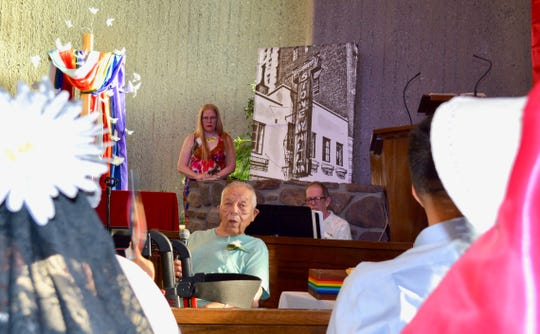 Dick Busby, seated center, a resident of the Stonewall Gardens assisted living village, talks about what he saw in New York the night the Stonewall uprising began in 1969. He spoke June 27, 2019, at the United Methodist Church of Palm Springs during its Stonewall Commemoration 50th Anniversary service.
