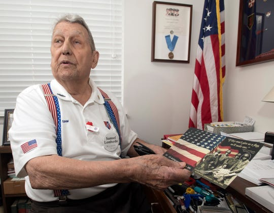 World War II veteran Sam Lombardo shares his memories of the Battle of the Bulge during an interview on Thursday, June 27, 2019. The Fort Walton resident will be celebrating his 100th birthday with a party at the Pensacola Yacht Club and watching the Blue Angels airshow.