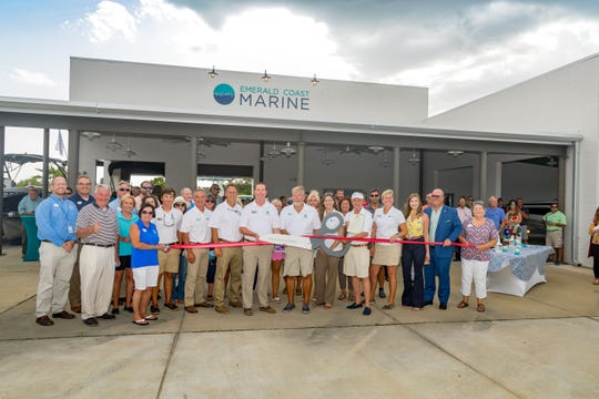 Emerald Coast Marine Group, based in Niceville, cut the ribbon Thursday on its second location at The Wharf in Orange Beach.