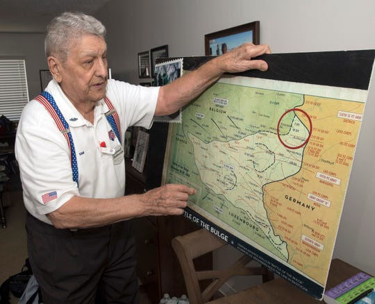 World War II veteran Sam Lombardo shares his memories of the Battle of the Bulge during an interview June 27.