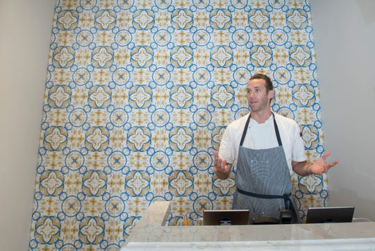 Executive Chef James Briscione talks about he tile work in the entraceway at the new Angelena's Ristorante Italiano in downtown Pensacola on Thursday, June 27, 2019.