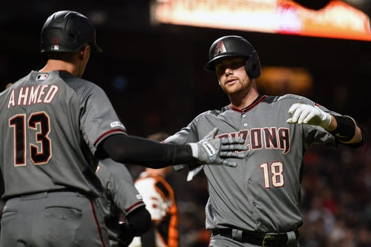 Jun 27, 2019; San Francisco, CA, USA; Arizona Diamondbacks catcher Carson Kelly (18) celebrates with shortstop Nick Ahmed (13) after hitting a two-run home run against the San Francisco Giants in the seventh inning at Oracle Park. Mandatory Credit: Cody Glenn-USA TODAY Sports