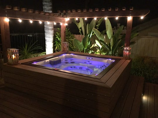 Use an umbrella, pergola, or other shade structure to keep the sun from shining directly on the hot tub during the day. This will reduce the amount of heat that collects and make it easier to cool the water before soaking, even on the hottest days.
