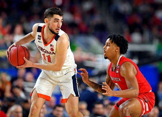 Virginia guard Ty Jerome is defended by Texas Tech guard Kyler Edwards during the first half of the NCAA championship game at US Bank Stadium.