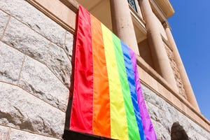Arizona Secretary of State Katie Hobbs hung a gay pride flag on the balcony of the historic state Capitol building on Friday, June 28, 2019.