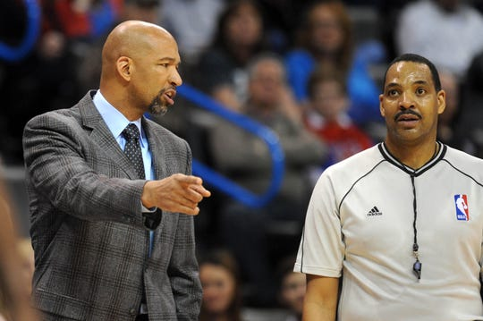 Feb 6, 2015; Oklahoma City, OK, USA; New Orleans Pelicans head coach Monty Williams talks to an NBA official about a call in action against the Oklahoma City Thunder at Chesapeake Energy Arena. Mandatory Credit: Mark D. Smith-USA TODAY Sports