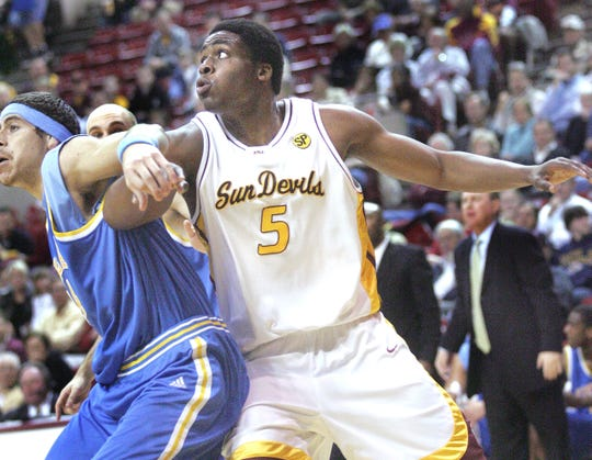 ASU's Ike Diogu tries muscle free of UCLA center Lorenzo Mata during a game Jan. 13, 2005 at Wells Fargo Arena.