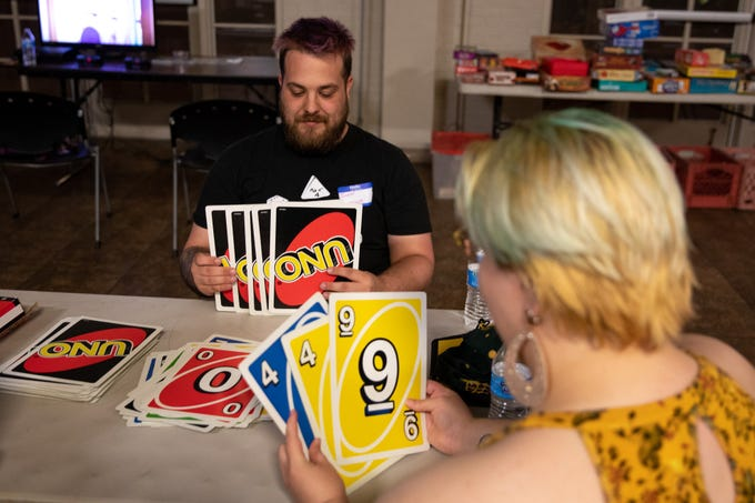 Felix Rachelle (right) plays Uno with  John Dam at First Union Church in Phoenix on April 20, 2019.